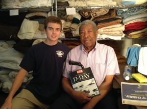 John Miller shares a D-Day memory with high school student Andrew Ragains visiting Access Housing's veterans facility. (The Washington Post/Hamil R. Harris)